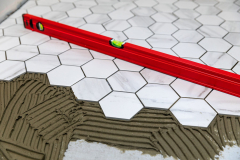tiling - laying marble texture hexagon tiles on the floor